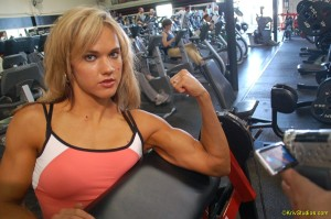 Lauren flexes during a workout shoot in Venice Beach.