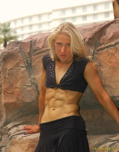 Natalie's chiseled abs and sexy stare makes you want to drop what you're doing cold turkey.