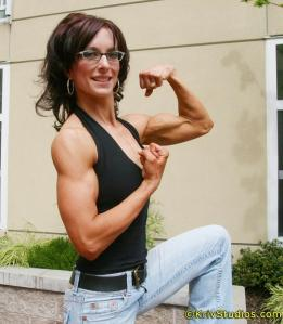 Muscle Mom: Julie, proud parent of four, shows off her great shape.